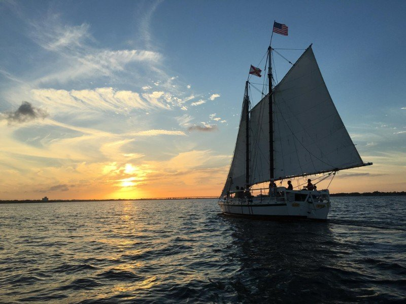 Schooner Lily departs on a sunset sail.