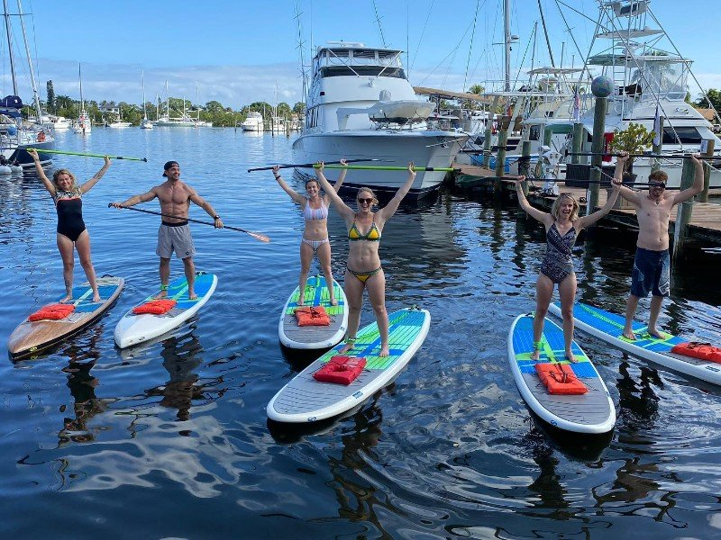 A group of stand up paddleboarders in Martin County